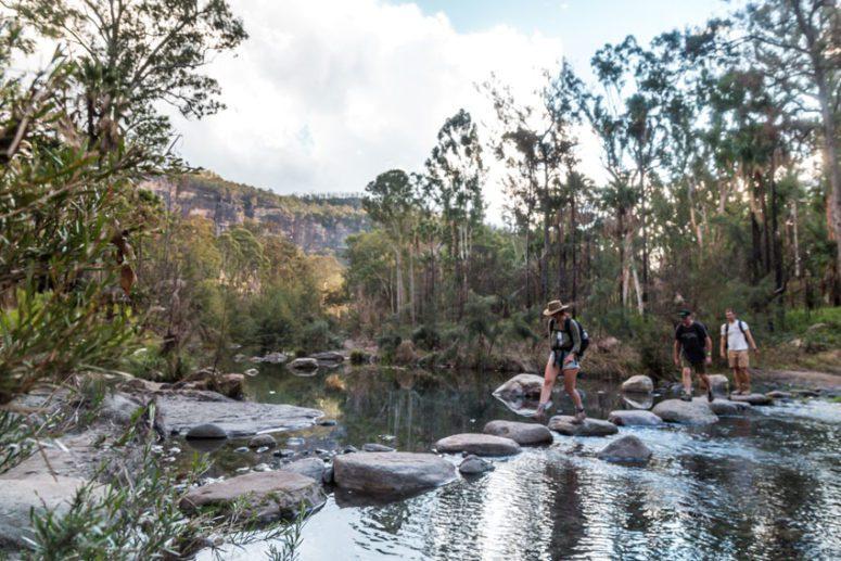 tourists crossing creek